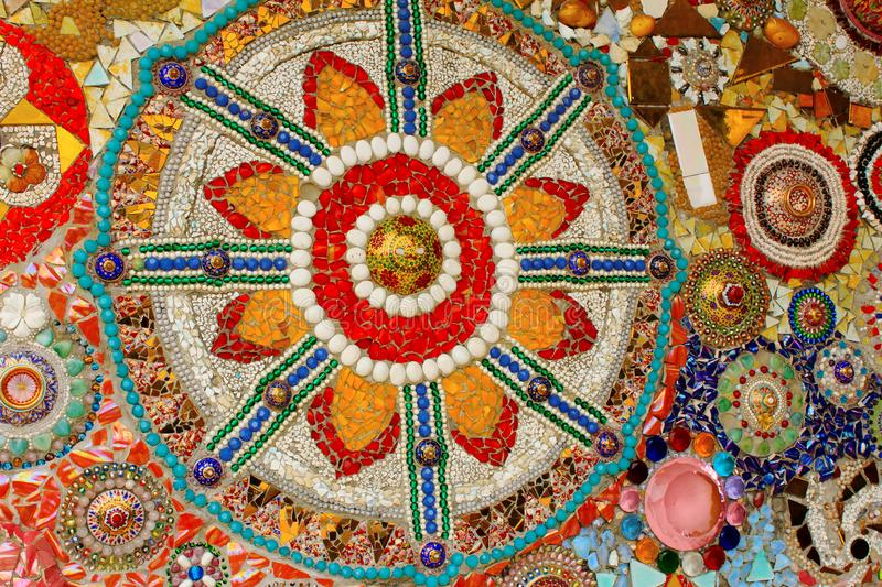 Lovely colorful mosaic designs made with pottery shards and glass gems, at Pha Sorn Kaew, in Khao Kor, Phetchabun, Thailand. Lovely colorful mosaic designs made stock image
