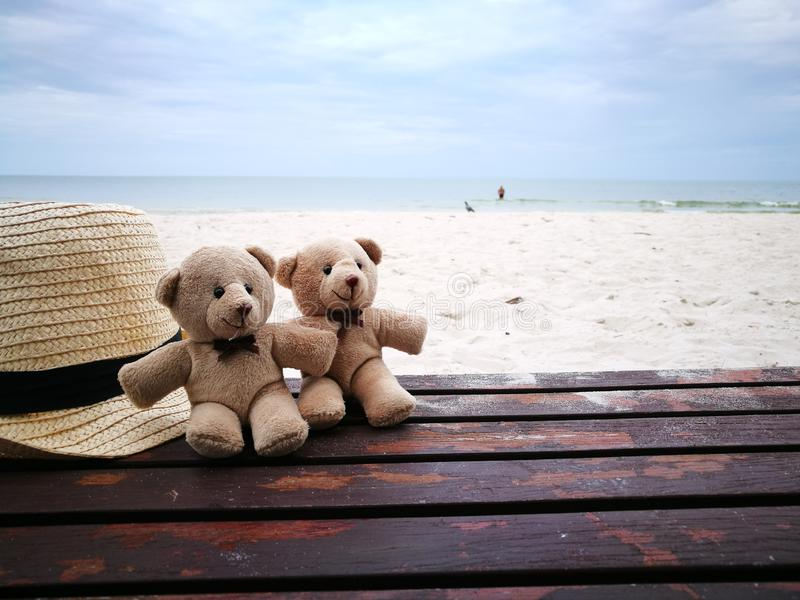 Lovely couple bear with white hat on balcony on white sand beach with Hat at Hua Hin beach, can see riding horse activity, item an royalty free stock photo
