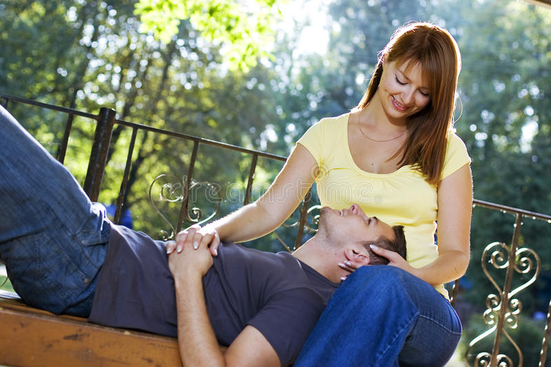 Lovely couple on the bench stock photos