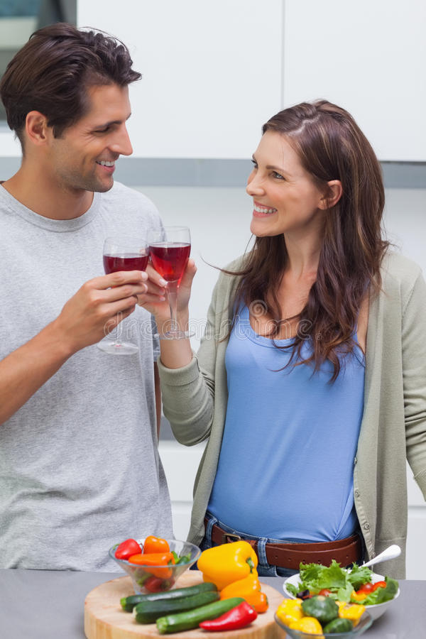 Download Lovely Couple Clinking Glass Of Red Wine Stock Image - Image: 33215207