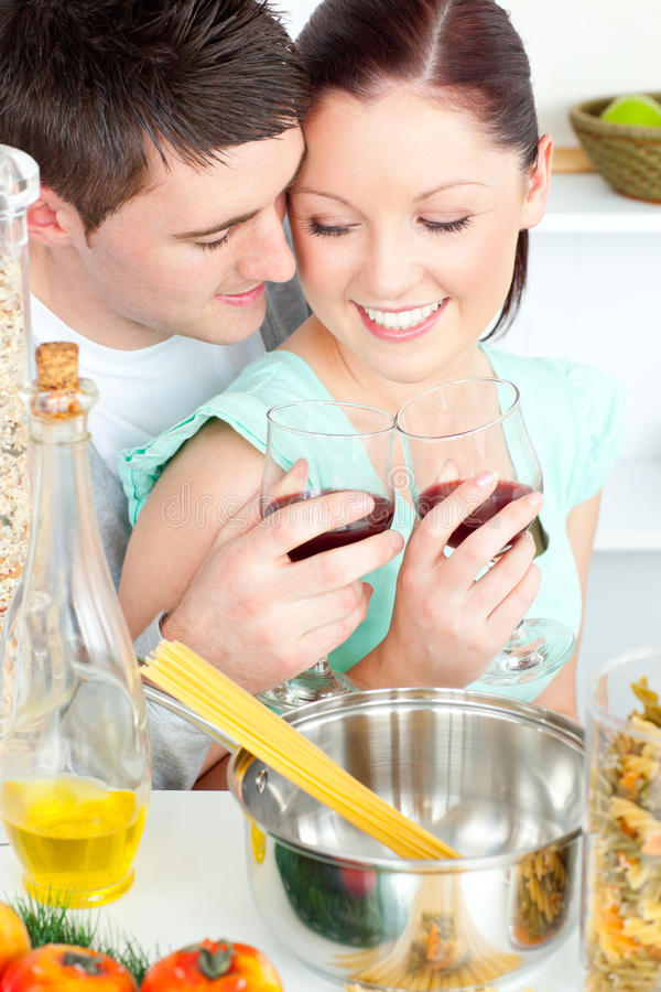Download Lovely Couple Clinking Glasses While Cooking Pasta Stock Photo - Image: 15786052