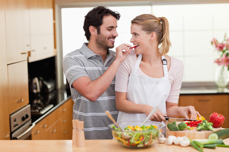 Lovely couple cooking stock image