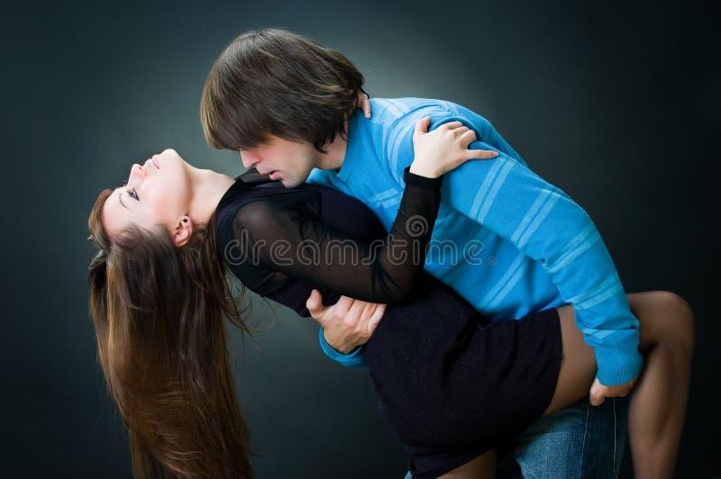 Lovely couple dancing. Studio shot stock image
