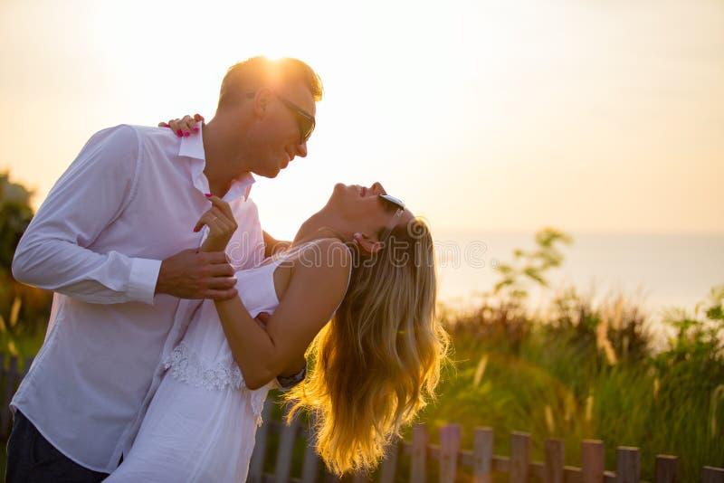 Lovely couple dancing outside in sunset. Lovely and very happy couple dancing outside in sunset stock image