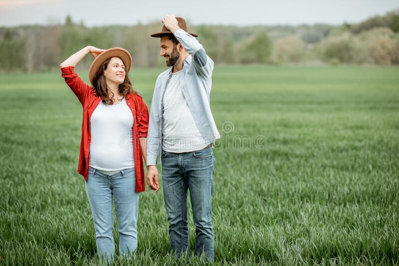 Lovely couple on the greenfield royalty free stock photos