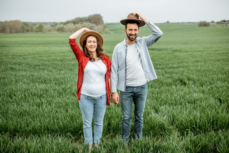 Lovely couple on the greenfield stock image