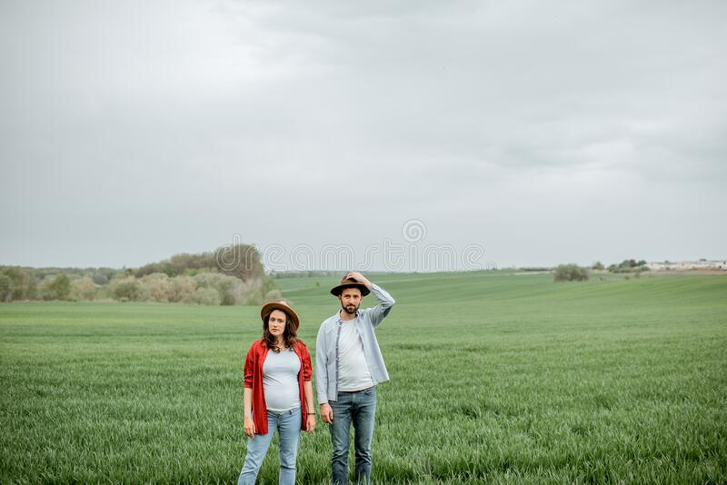 Lovely couple on the greenfield stock photography