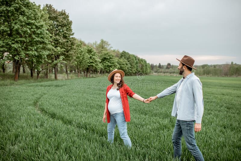 Lovely couple on the greenfield royalty free stock image