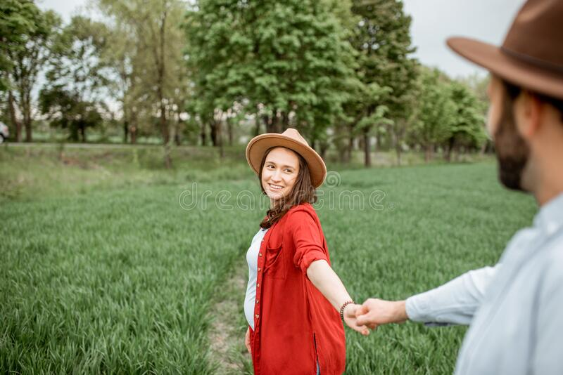 Lovely couple on the greenfield royalty free stock images