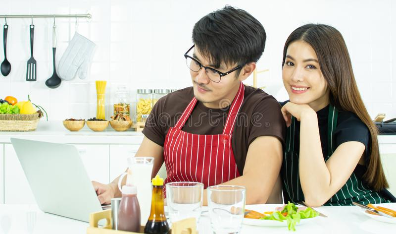 A lovely couple having breakfast while working in the morning stock photos