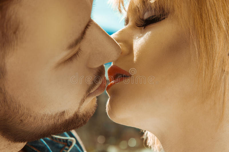 Lovely couple kissing each other outdoors stock image