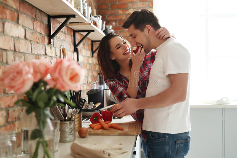 Lovely couple. In the kitchen royalty free stock images