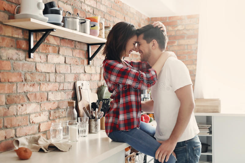 Lovely couple. In the kitchen stock photography