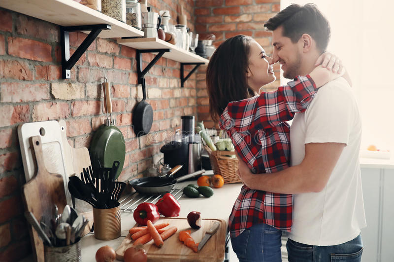 Lovely couple. In the kitchen stock images