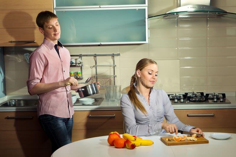 Lovely couple on kitchen royalty free stock photos