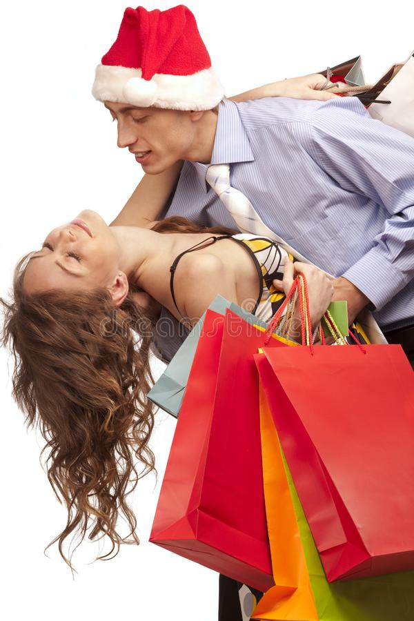 Download Lovely Couple Making Christmas Shopping Stock Photo - Image of girl, expression: 17318622