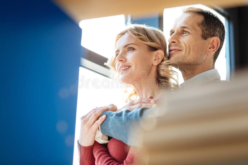 Nice positive couple standing together stock photos