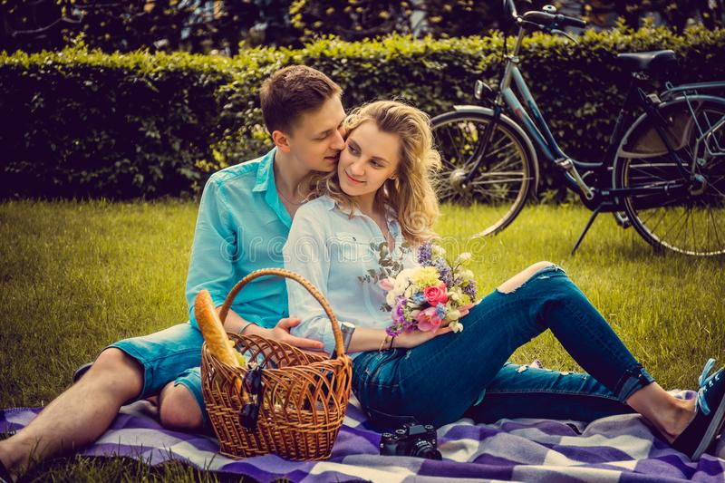 Lovely couple on picnik in a park. royalty free stock photos