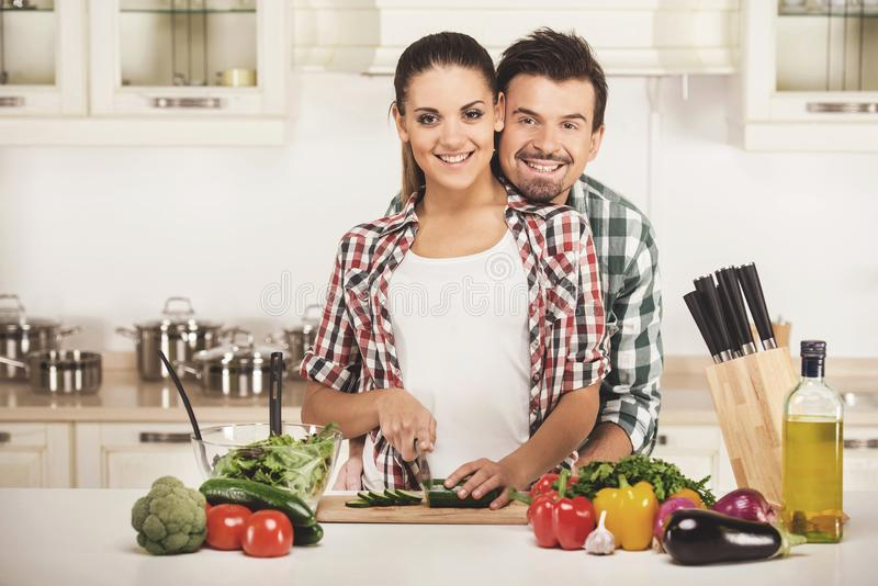 Lovely couple preparing healthy meal in kitchen. royalty free stock photo