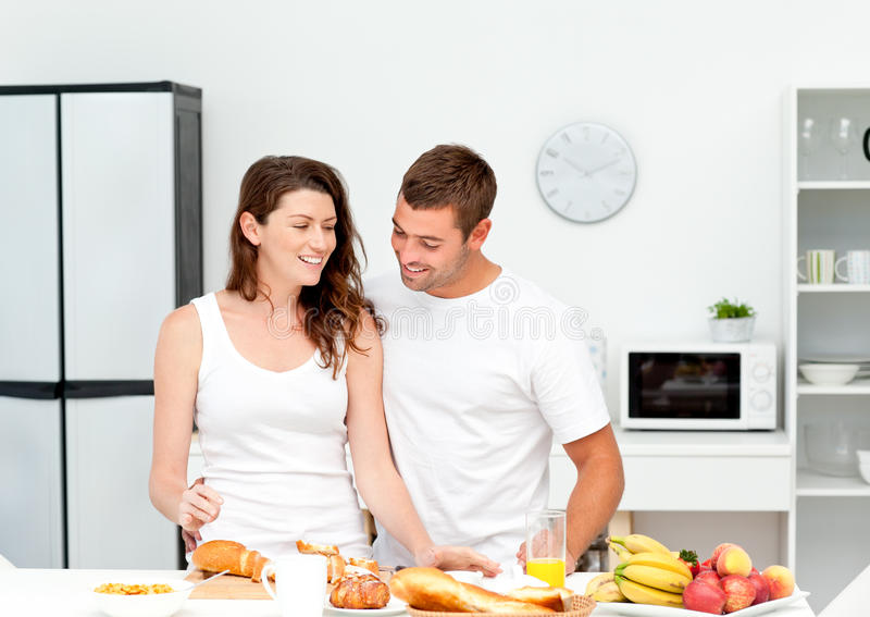 Download Lovely Couple Preparing Their Breakfast Together Stock Photo - Image: 17279000