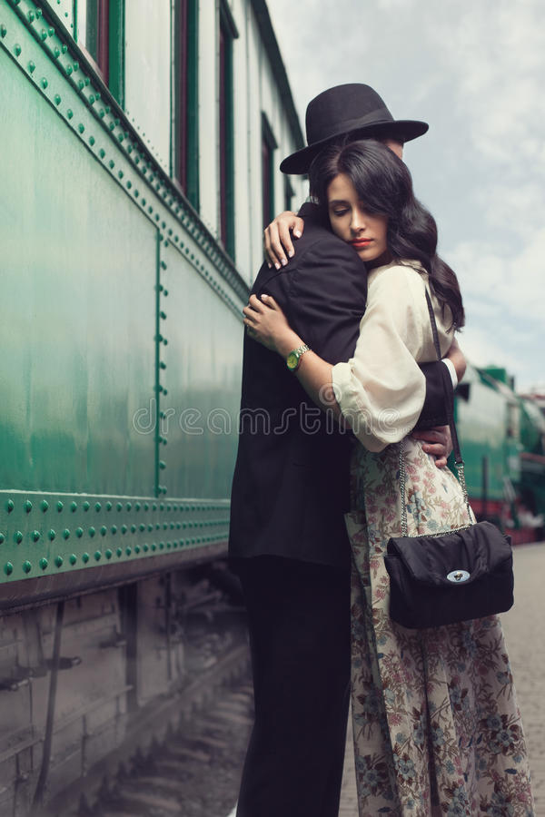 Lovely couple on railway station. Portrait of lovely couple on railway station royalty free stock images