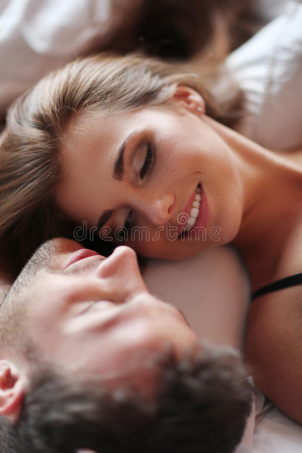 Lovely couple. Relationship. Lovely couple in bed stock photo
