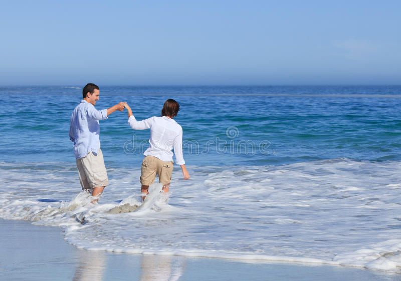 Download Lovely couple in the sea stock photo. Image of handsome - 18700756