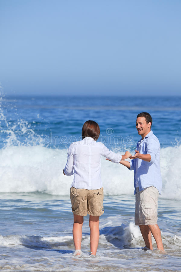 Download Lovely couple in the sea stock image. Image of coast - 18700761