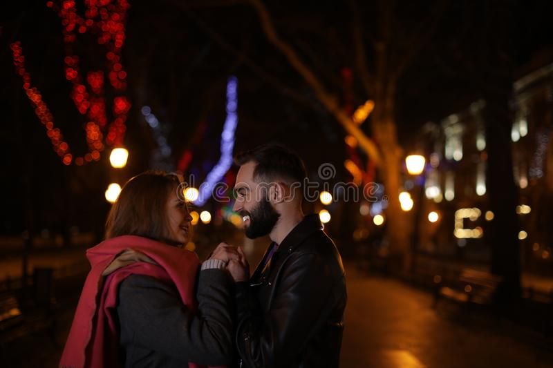 Lovely couple spending time in city. At night stock photo