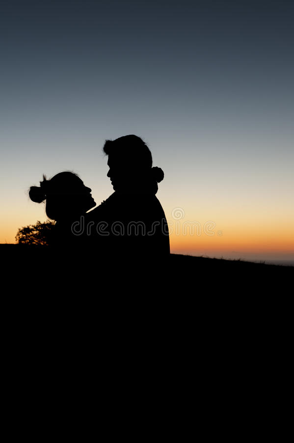 Lovely couple sunset art stock photos