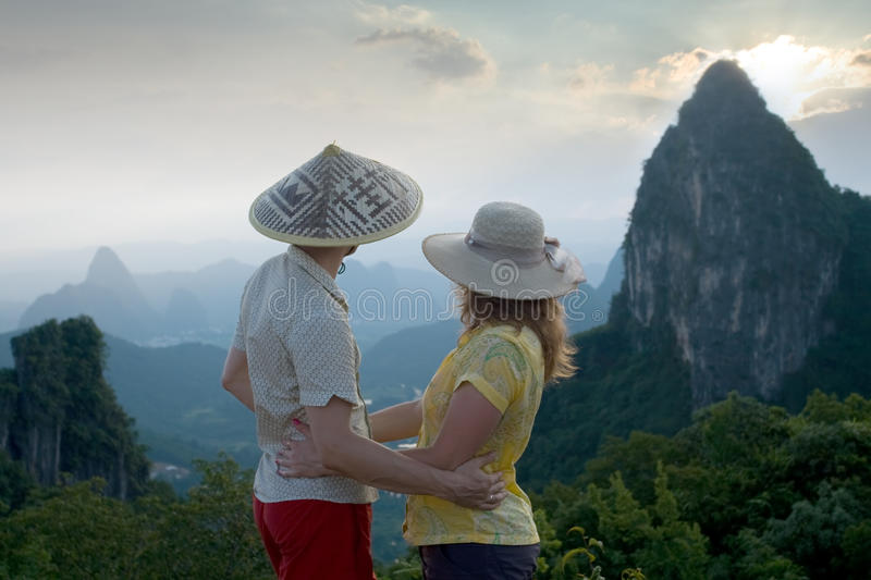 Lovely couple at sunset on top of the Chinese mountain of Moon Hill royalty free stock photography