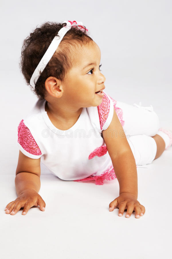 Lovely crawling little girl stock photography