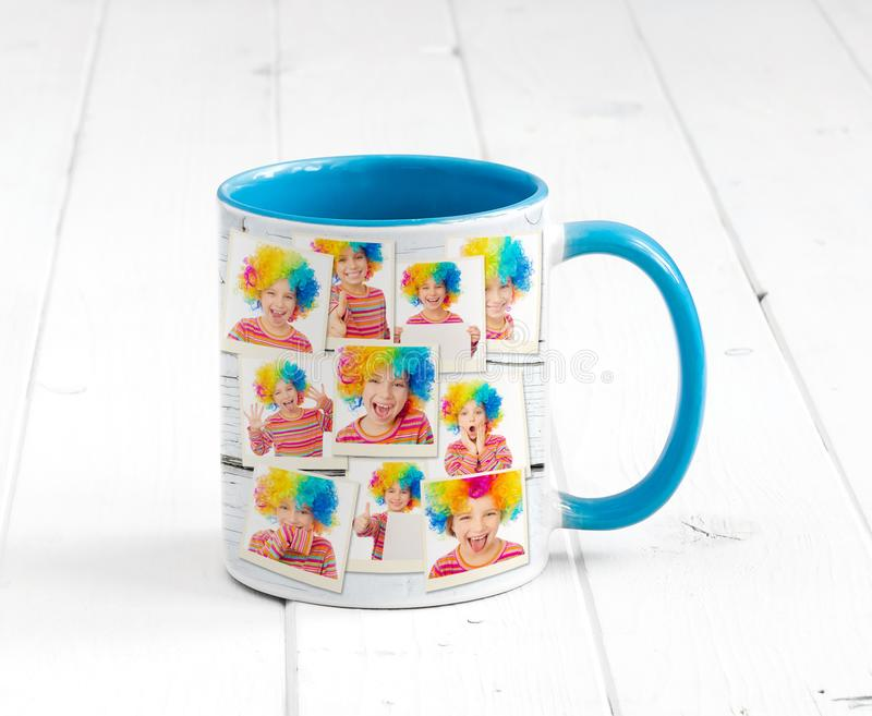 Lovely cup blue on inside and clowns print. Lovely cup blue on the inside with light blue handle and a print, smily clowns royalty free stock image