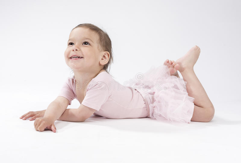 Lovely and Cute Caucasian Female Child Laying on Floor stock photo