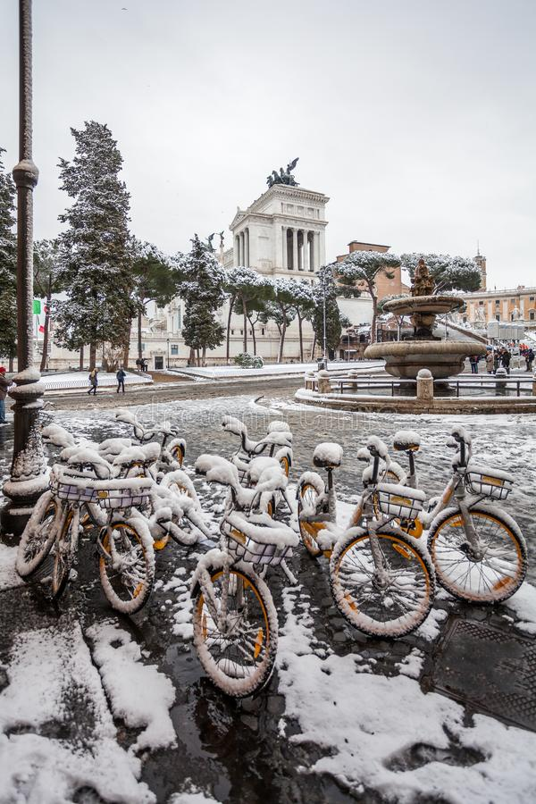 A lovely day of snow in Rome, Italy, 26th February 2018: a beautiful view of Altare della Patria and Fontana dell`Aracoeli under. The snow royalty free stock photography