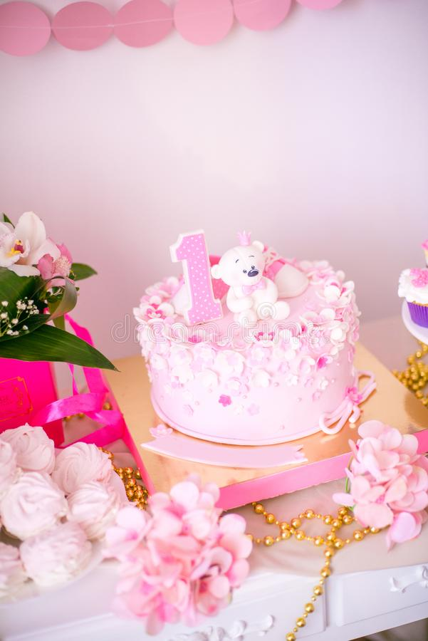A lovely delicious candy bar in pink and gold colors for a little princess on her 1st birthday royalty free stock image