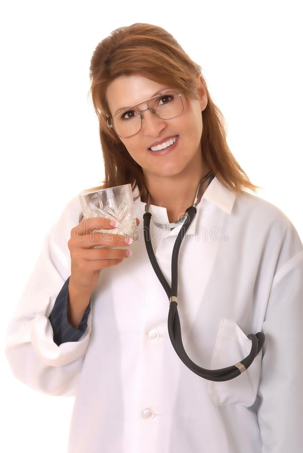 Lovely Doctor Or Nurse Drinking Milk royalty free stock photography