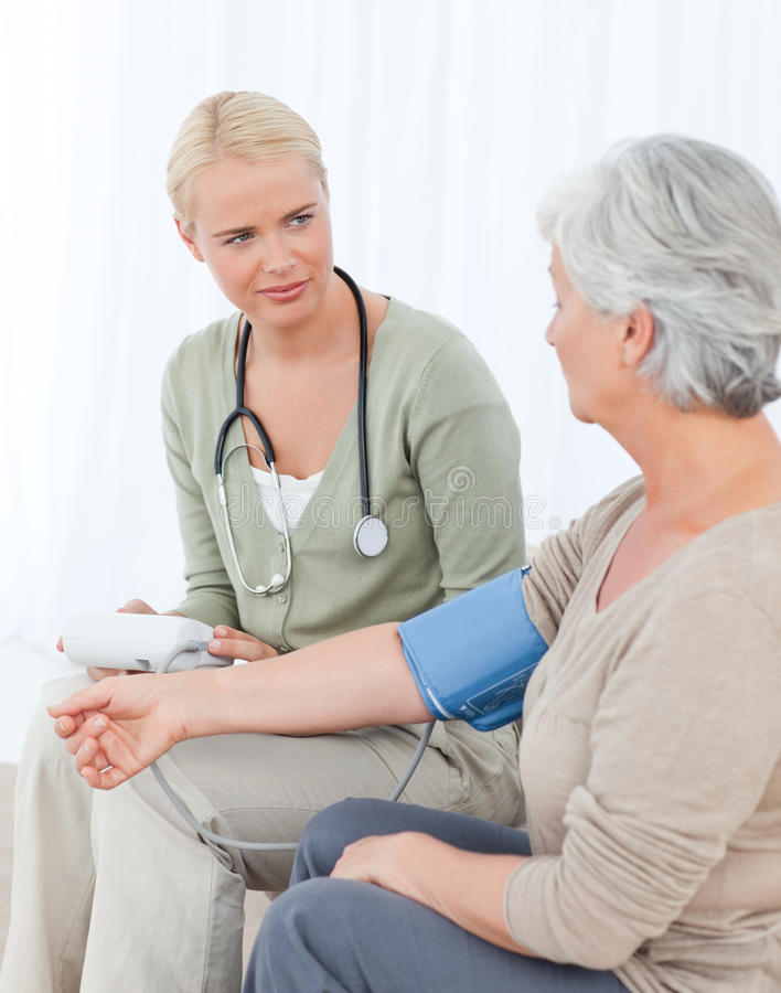 Download Lovely Doctor Taking The Blood Pressure Stock Image - Image: 18107957