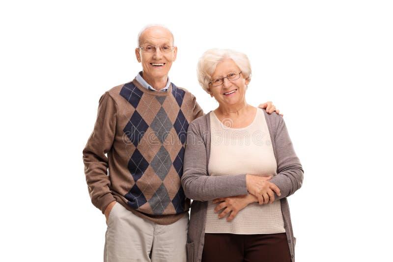 Lovely elderly couple posing together. Studio shot of a lovely elderly couple posing together isolated on white background royalty free stock photo
