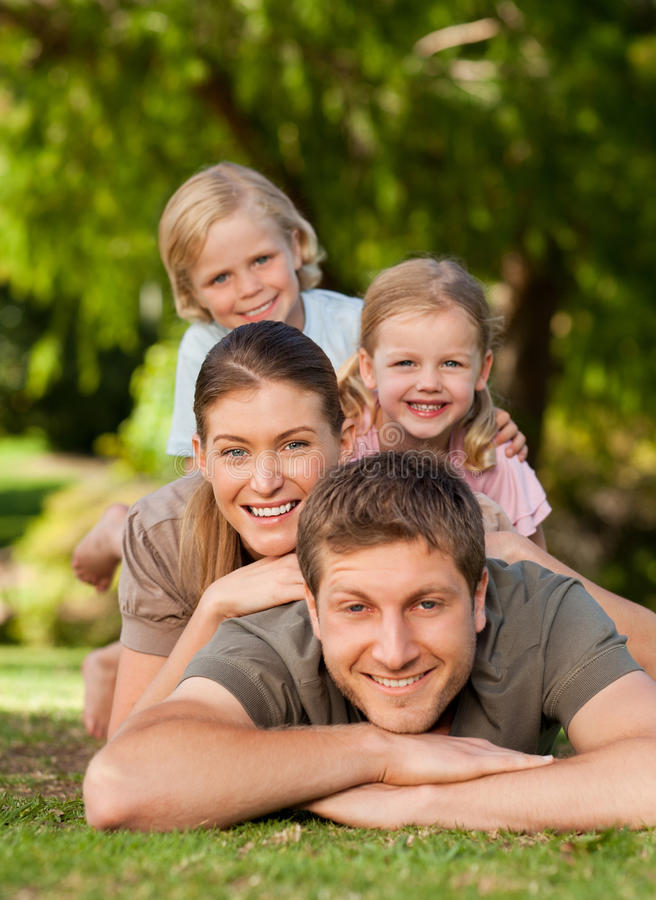 Lovely family in the park. Sharing good moments together stock photos