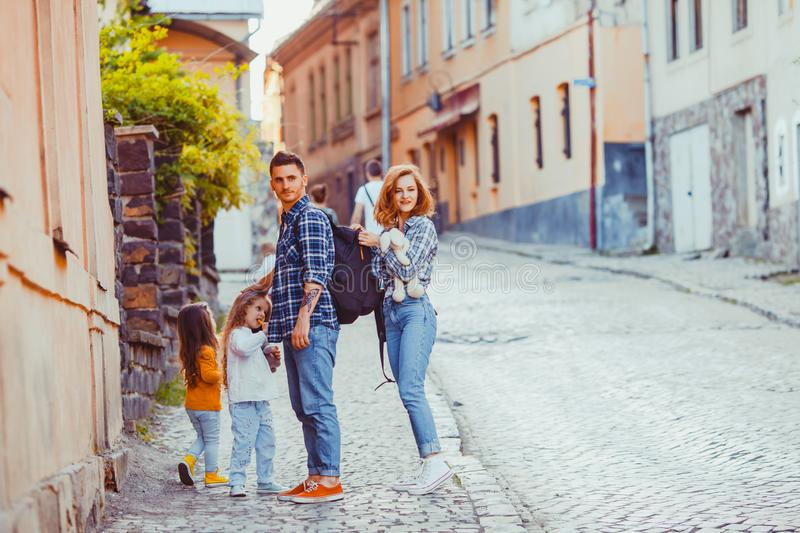 Lovely family of travelers standing on the ancient street royalty free stock images