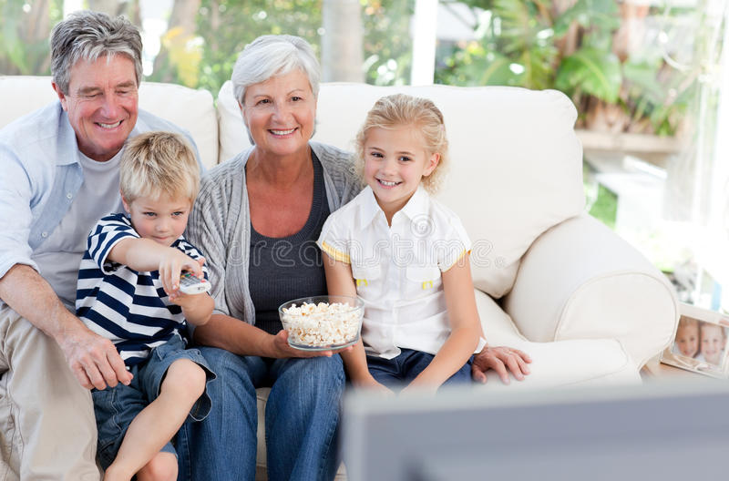 Download Lovely family watching tv stock photo. Image of holiday - 18108148