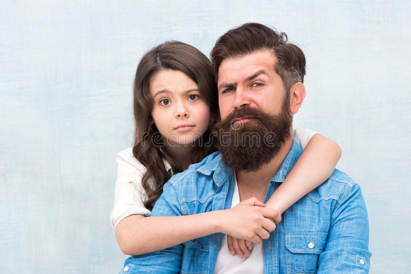 Lovely father and cute kid. Father and daughter hug light background. Family hug. Strengthening father daughter royalty free stock image