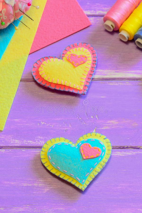 Lovely felt hearts. Valentines Day symbols. Cute homemade Valentines day gifts. Simple hand sewing project for kids. Vertical phot. Valentine decorations idea royalty free stock photos
