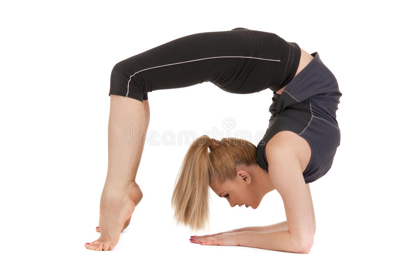 Lovely fitness instructor. Bright picture of lovely fitness instructor over white royalty free stock photography