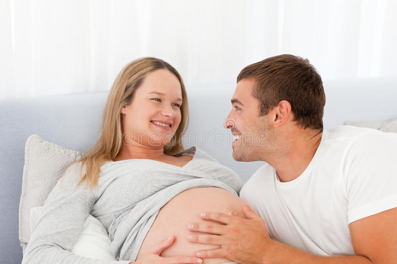 Download Lovely Future Parents Resting On A Bed Stock Image - Image: 17170817