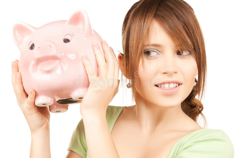 Lovely Girl With Big Piggy Bank Royalty Free Stock Photos