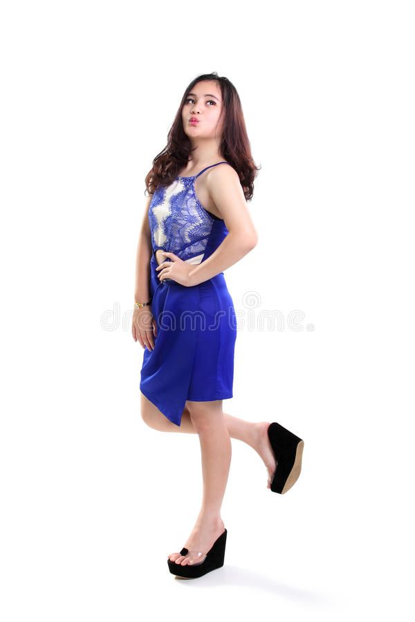 Lovely girl in blue dress walking royalty free stock photography
