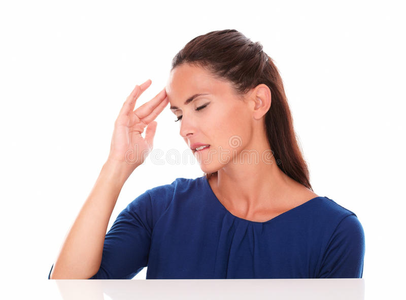 Lovely girl with closed eyes suffering headache. In white background royalty free stock photos