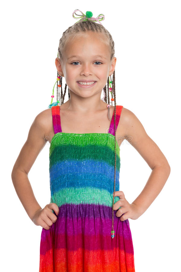 Lovely girl in a colorful dress stock photos